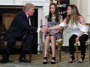 President Donald Trump and students at yesterday's White House listening session.