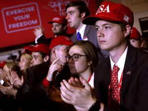 Young supporters cheer as U.S. President Donald Trump addresses CPAC.