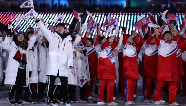 North Korea and South Korea teams walk together in the Parade of Athletes during the Closing Ceremony of the 2018 Winter Olympic Games.
