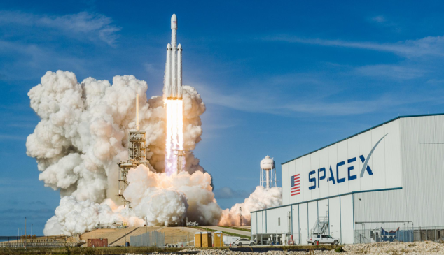 The Falcon Heavy rocket lifts off from Kennedy Space Center.