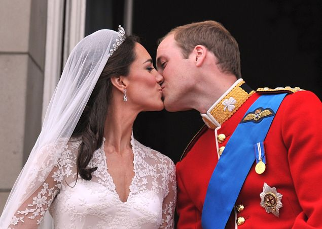 LONDON, ENGLAND - APRIL 29: Their Royal Highnesses Prince William, Duke of Cambridge and Catherine, Duchess of Cambridge kiss on the balcony at Buckingham Palace during the Royal Wedding of Prince William to Catherine Middleton on April 29, 2011 in London, England. The marriage of the second in line to the British throne was led by the Archbishop of Canterbury and was attended by 1900 guests, including foreign Royal family members and heads of state. Thousands of well-wishers from around the world have also flocked to London to witness the spectacle and pageantry of the Royal Wedding.