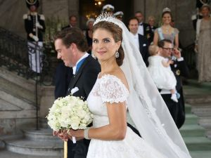 STOCKHOLM, SWEDEN - JUNE 08: Princess Madeleine of Sweden and Christopher O'Neill depart from the wedding ceremony of Princess Madeleine of Sweden and Christopher O'Neill hosted by King Carl Gustaf XIV and Queen Silvia at The Royal Palace on June 8, 2013 in Stockholm, Sweden.
