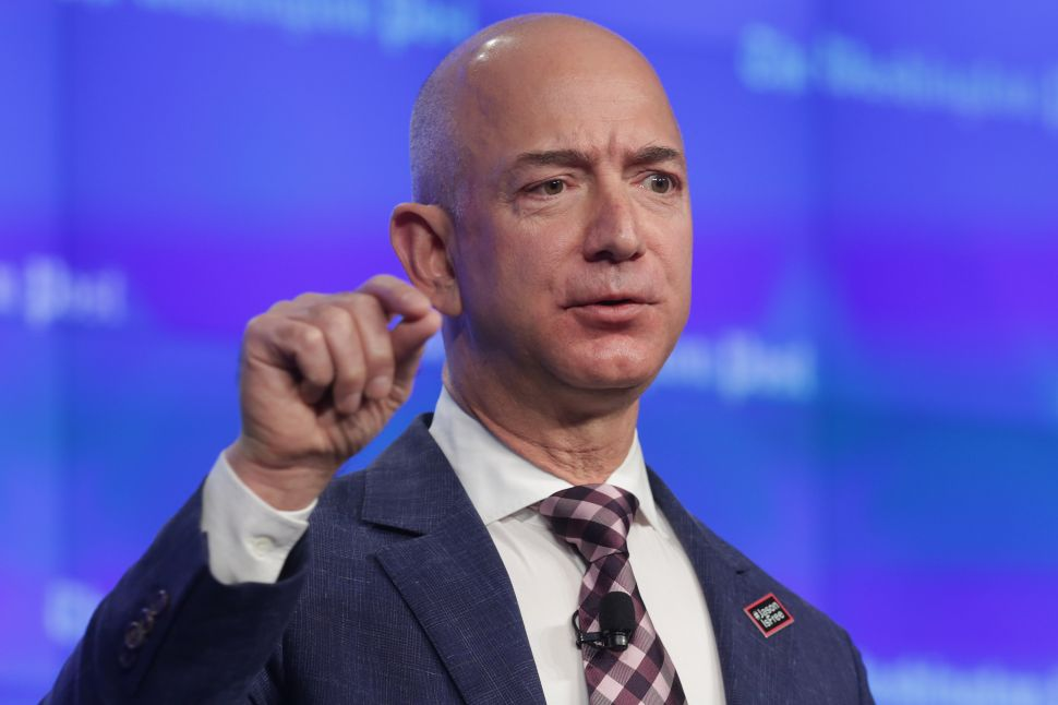 Trump Slams Amazon for Using US Postal Service as Cheap 'Delivery Boy'—But He's Wrong