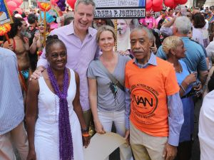 Mayor Bill de Blasio with wife Chirlane McCray; actress Cynthia Nixon; and activist Al Sharpton at the 2016 Pride march.