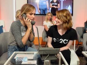 Kristen Wiig (L) and Emma Stone.
