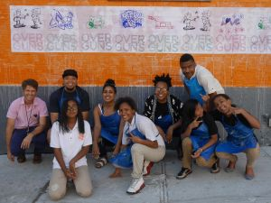 Students at MS 22 in front of a completed anti-gun violence mural.
