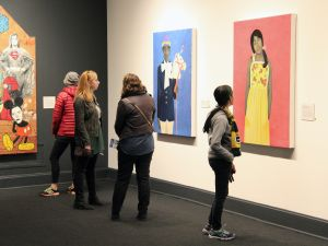 Viewers at NMWA in front of work by Amy Sherald.