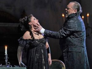 Anna Netrebko as Tosca is about to turn the tables on Scarpia (Michael Volle).