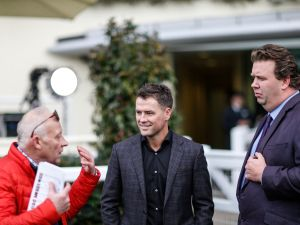 ASCOT, ENGLAND - NOVEMBER 24: Ex England footballer Michael Owen (C) chats with jockey coach Colin Brown (L) and Johnno Spence prior to riding in a charity race at Ascot racecourse on November 24, 2017 in Ascot, United Kingdom.