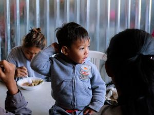 "Central American migrants during the ""Migrant Via Crucis"" caravan, as they have breakfast at Juventud 2000 shelter in Tijuana, Mexico on April 17, 2018."