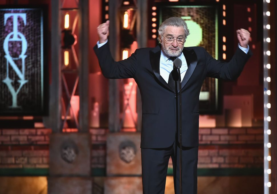 Trump Supporter Shows Off 'Keep America Great' Flag During Robert De Niro's Musical