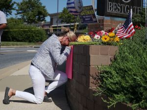 Lynne Griffin pays her respects at a makeshift memorial near the Capital Gazette where 5 people were shot and killed by a gunman on Thursday, on June 29, 2018 in Annapolis, Maryland. Griffin was a journalism student under John McNamara who was one of the people killed at the paper. Jarrod Ramos of Laurel Md. Has been arrested and charged with killing 5 people at the daily newspaper.