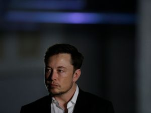 CHICAGO, IL - JUNE 14: Engineer and tech entrepreneur Elon Musk of The Boring Company listens as Chicago Mayor Rahm Emanuel talks about constructing a high speed transit tunnel at Block 37 during a news conference on June 14, 2018 in Chicago, Illinois. Musk said he could create a 16-passenger vehicle to operate on a high-speed rail system that could get travelers to and from downtown Chicago and O'hare International Airport under twenty minutes, at speeds of over 100 miles per hour.