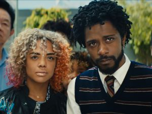 Tessa Thompson as Detroit and Lakeith Stanfield as Cassius Green in Sorry to Bother You.