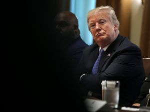 WASHINGTON, DC - AUGUST 01: (AFP OUT) U.S. President Donald Trump listens during a meeting with inner city pastors in the Cabinet Room of the White House on August 1, 2018 in Washington, DC. (Photo by )