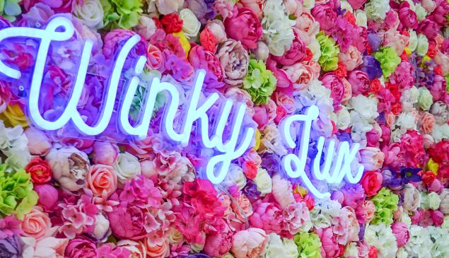 Winky Lux's beflowered storefront.