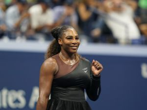 Serena Williams of the US celebrates her victory over Magda Linette of Poland during their 2018 US Open Women's Singles match at the USTA Billie Jean King National Tennis Center in New York on August 27, 2018. - Serena Williams made a triumphant return to the US Open on Monday, opening her bid for a record-tying 24th Grand Slam title with a 6-4, 6-0 first-round victory over Magda Linette.