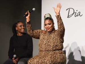 Venus Williams and Lizzo speak onstage during The Curvy Con 2018 in New York City.