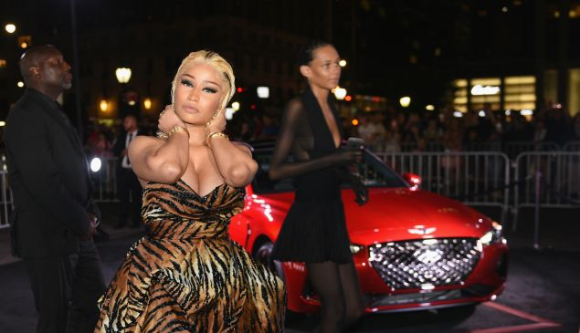 Nicki Minaj attending the Harper's Bazaar ICONS party, where Cardi B threw a shoe at her.