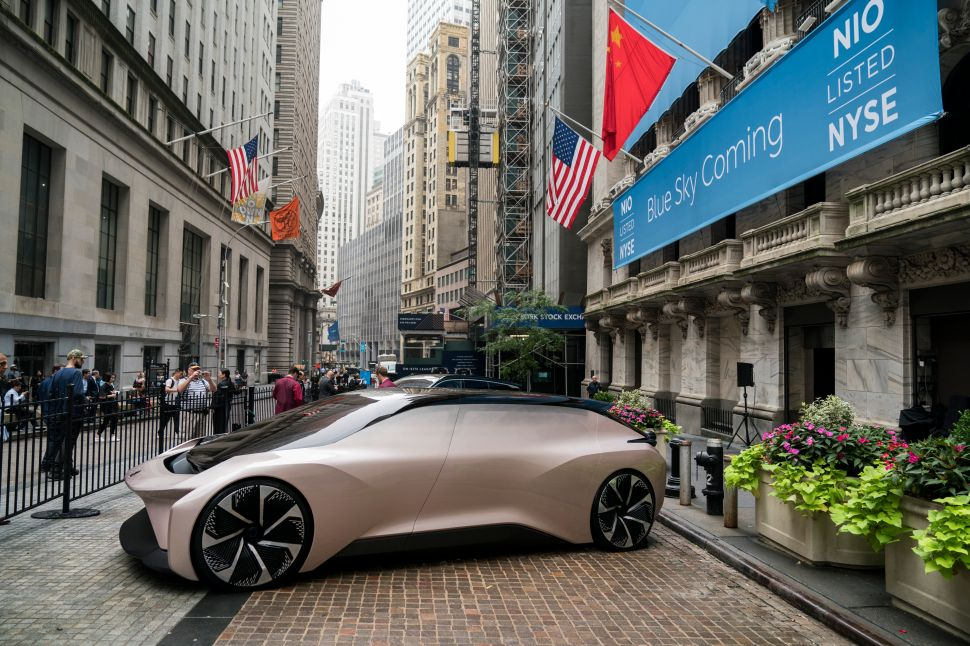 A NIO vehicle sits outside of the New York Stock Exchange on Wednesday.