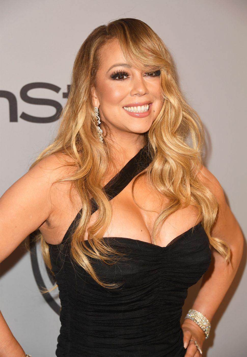"Mariah Carey Sips Wine, Swears in Lingerie in Her New ""GTFO"" Video"