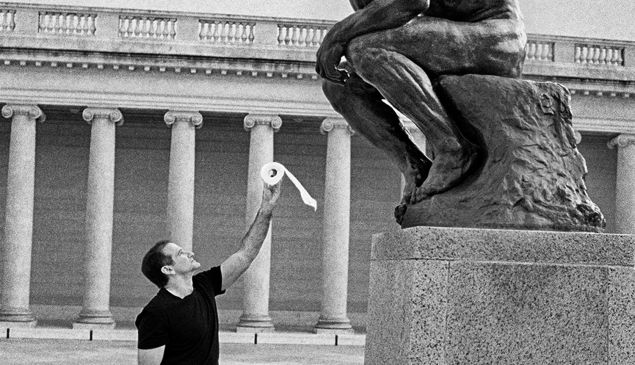 Robin Williams with Rodin's Thinker, photographed by Arthur Grace.