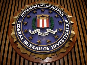 The seal of the FBI hangs in the Flag Room at the bureau's headquarters.