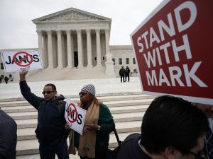 Activists rally in front of the U.S. Supreme Court ahead of justices hearing the case, Janus v. AFSCME.