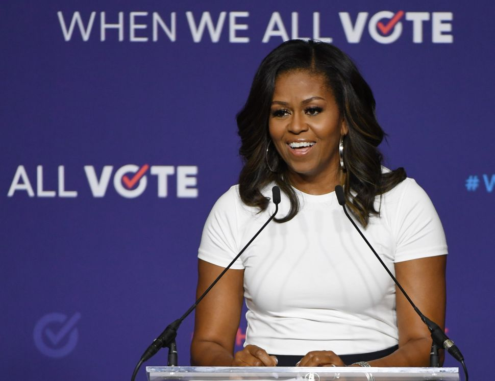 Michelle Obama Reveals She Miscarried and Used IVF to Have Her Daughters