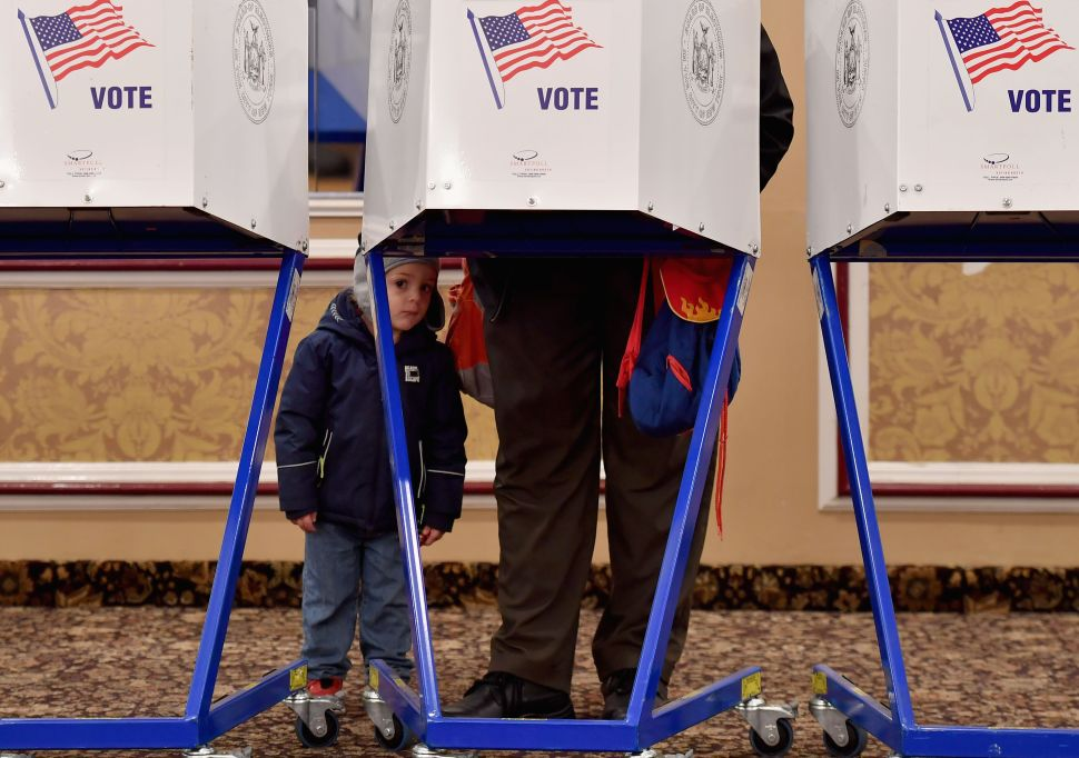 Voters Battle Pouring Rain, Malfunctioning Machines and Huge Lines to Cast Ballots