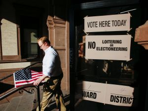 A man exits a polling station after casting his ballot during New Jersey's primary elections on June 7, 2016 in Hoboken, New Jersey.