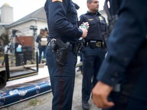 New Jersey police officers at a crime scene in Paterson, N.J.