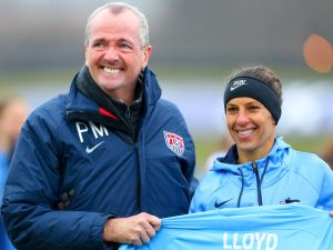 Sky Blue FC midfielder Carli Lloyd (10) poses for a photo with New Jersey Governor Phil Murphy in recognition of her 100th Goal prior to the first half of the National Womens Soccer League game between Sky Blue FC and Seattle Reign FC on April 15, 2018, at Yurcak Field in Piscataway, NJ.