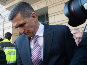 Former National Security Advisor General Michael Flynn leaves after the delay in his sentencing hearing at US District Court in Washington, DC, December 18, 2018.