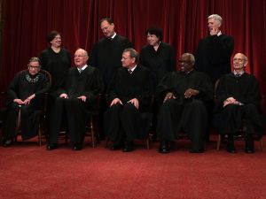Front row from left, U.S. Supreme Court Associate Justice Ruth Bader Ginsburg, Former Associate Justice Anthony M. Kennedy, Chief Justice John G. Roberts, Associate Justice Clarence Thomas, and Associate Justice Stephen Breyer, back row from left, Associate Justice Elena Kagan, Associate Justice Samuel Alito Jr., Associate Justice Sonia Sotomayor, and Associate Justice Neil Gorsuch pose for a group portrait in the East Conference Room of the Supreme Court June 1, 2017 in Washington, DC.