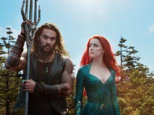 Jason Momoa and Amber Heard in Aquaman.