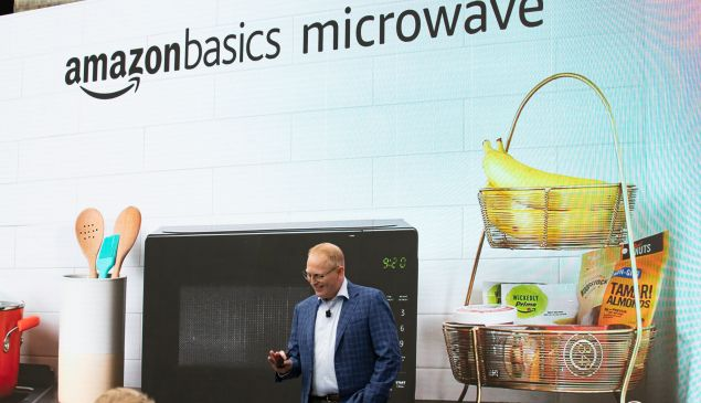"""Dave Limp, Senior Vice President of Amazon Devices, intoduces the """"amazonbasics microwave,"""" which can be controlled by an Alexa, on September 20, 2018."""