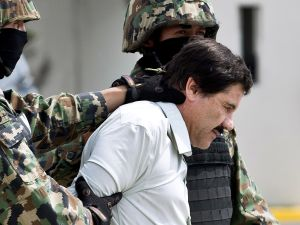 El Chapo Guzman is escorted by Marines as he is presented to the press on February 22, 2014 in Mexico City.