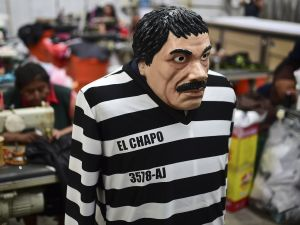 A costume and a mask representing Mexican drug trafficker El Chapo.