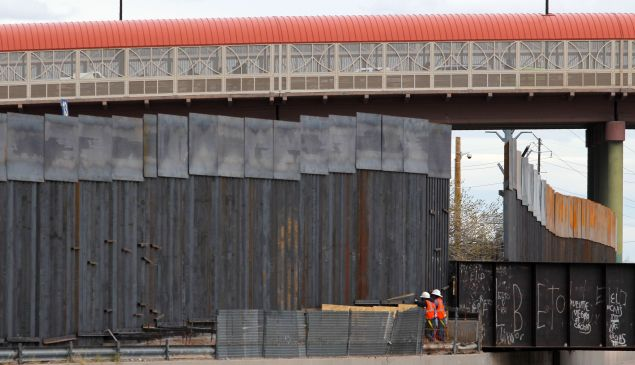 U.S. workers build the border wall between El Paso, Texas and Ciudad Juarez, Mexico on February 5, 2019.