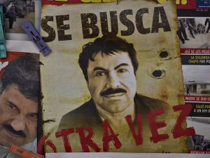 "A poster with the face of Mexican drug lord Joaquin ""El Chapo"" Guzman."