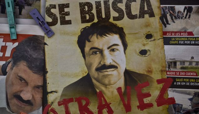 """A poster with the face of Mexican drug lord Joaquin """"El Chapo"""" Guzman."""