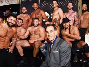 Hunk-O-Mania founder Armand Peri with strippers after a recent show at the Copacabana in New York City.