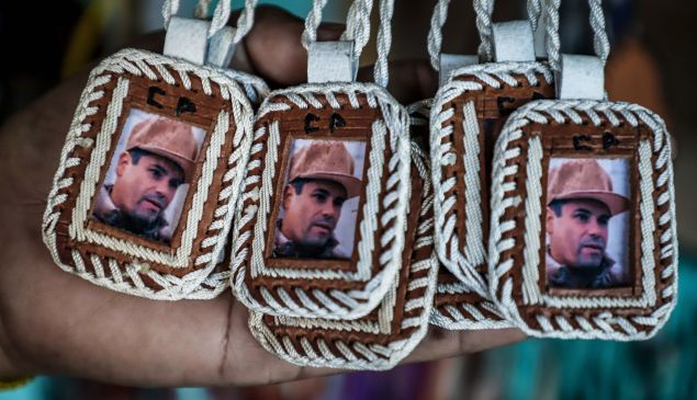 "Pendants bearing the image of Mexican drug lord Joaquin ""El Chapo"" Guzman, are displayed for sale at the narco-saint Jesus Malverde chapel in Culiacan, Sinaloa state in northwest Mexico, on February, 19, 2018."