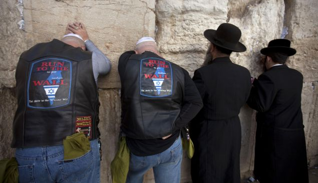 US bikers and supporters of Israel pray next to orthodox Jews at the Western Wall in Jerusalem.