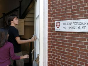 Students enter the Admissions Building on the campus of Harvard University.