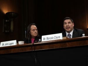 CEO of T-Mobile US Inc. John Legere (L) and Executive Chairman of Sprint Corporation Marcelo Claure (R) testify during a hearing before the Antitrust, Competition Policy and Consumer Rights Subcommittee of Senate Judiciary Committee on June 27, 2018.