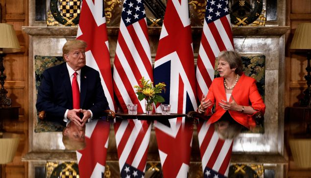 U.S. President Donald Trump listens to Britain's Prime Minister Theresa May.