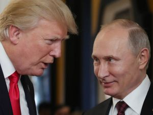 U.S. President Donald Trump (L) chats with Russia's President Vladimir Putin (R).