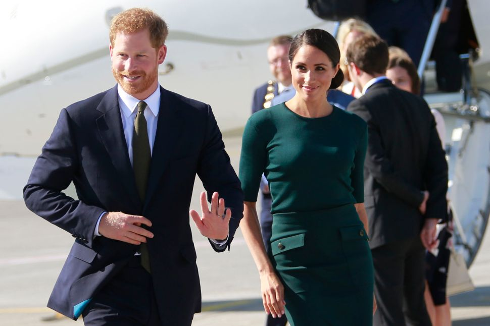 Why Prince Harry and Meghan Markle Won't Come to America This Year